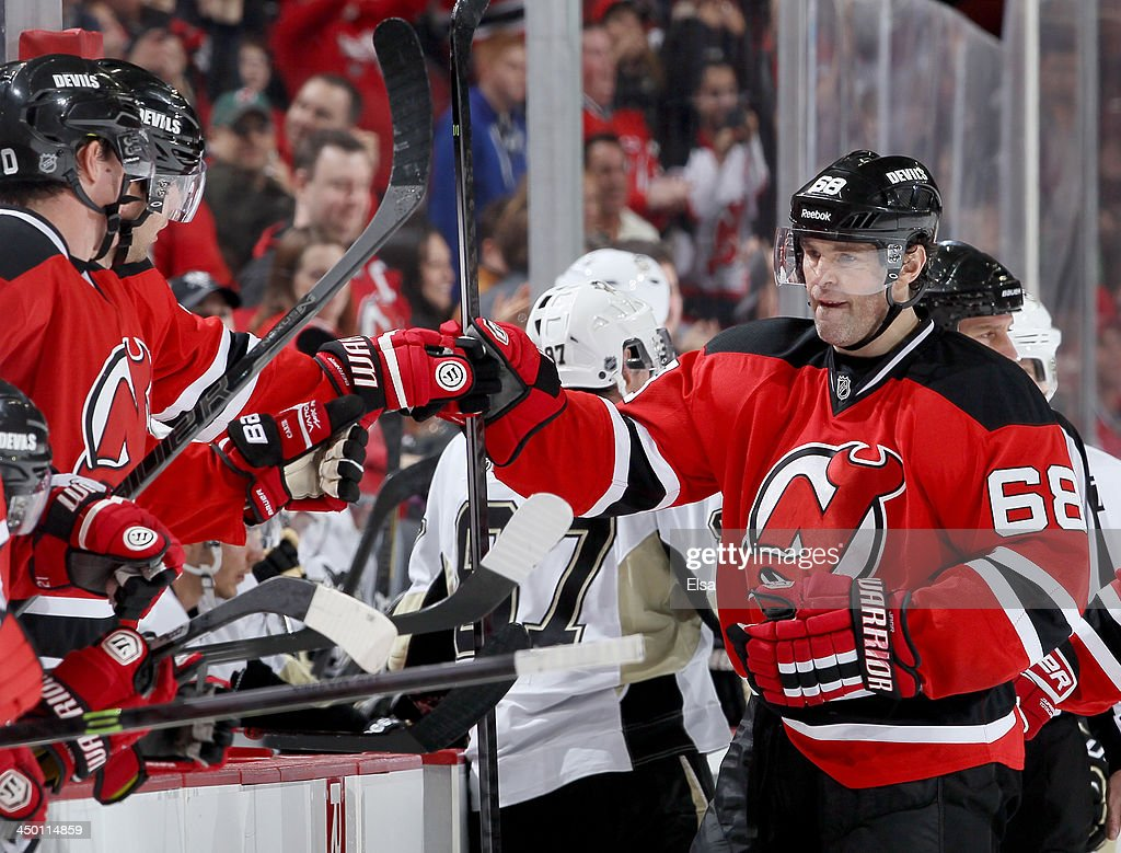 Jaromir Jagr of the New Jersey Devils celebrates is goal with teammates on the bench during the third period against the Pittsburgh Penguins at...