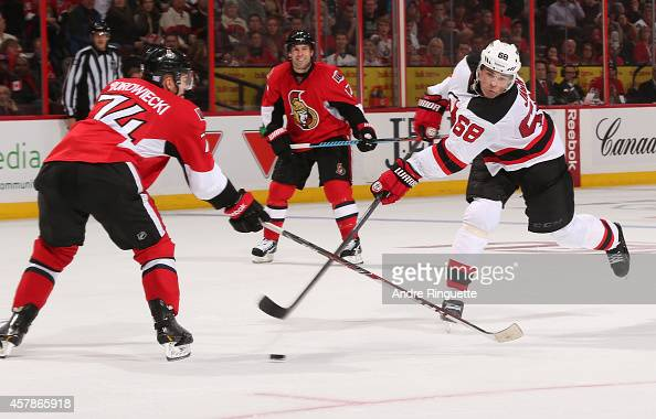 Jaromir Jagr of the New Jersey Devils scores the overtime winning goal on this wristshot that gets by Mark Borowiecki of the Ottawa Senators at...