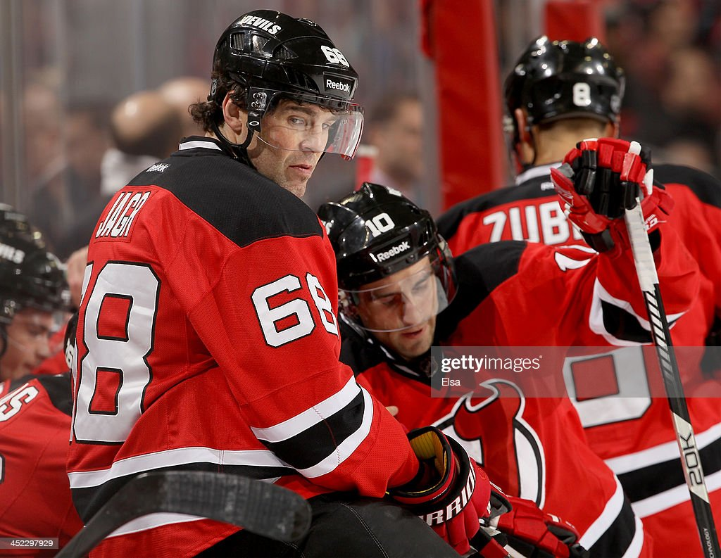 Jaromir Jagr #68 of the New Jersey Devils sits on the bench during a stop in play in the first period against the Carolina Hurricanes at Prudential Center on November 27, 2013 in Newark, New Jersey.