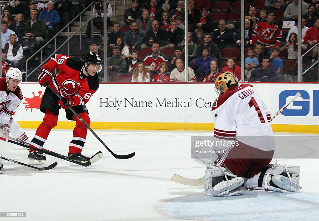 Jaromir Jagr #68 of the New Jersey Devils takes the shot at <a gi-track='captionPersonalityLinkClicked' href=/galleries/search?phrase=Thomas+Greiss&family=editorial&specificpeople=695275 ng-click='$event.stopPropagation()'>Thomas Greiss</a> #1 of the Phoenix Coyotes at the Prudential Center on March 27, 2014 in Newark, New Jersey. The Coyotes defeated the Devils 3-2 in the shootout.