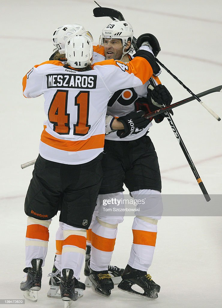Jaromir Jagr #68 of the Philadelphia Flyers celebrates his overtime goal with <a gi-track='captionPersonalityLinkClicked' href=/galleries/search?phrase=Jakub+Voracek&family=editorial&specificpeople=4111797 ng-click='$event.stopPropagation()'>Jakub Voracek</a> #93 and <a gi-track='captionPersonalityLinkClicked' href=/galleries/search?phrase=Andrej+Meszaros&family=editorial&specificpeople=617818 ng-click='$event.stopPropagation()'>Andrej Meszaros</a> #41 during their NHL game against the Winnipeg Jets at MTS Centre on February 21, 2012 in Winnipeg, Manitoba, Canada.