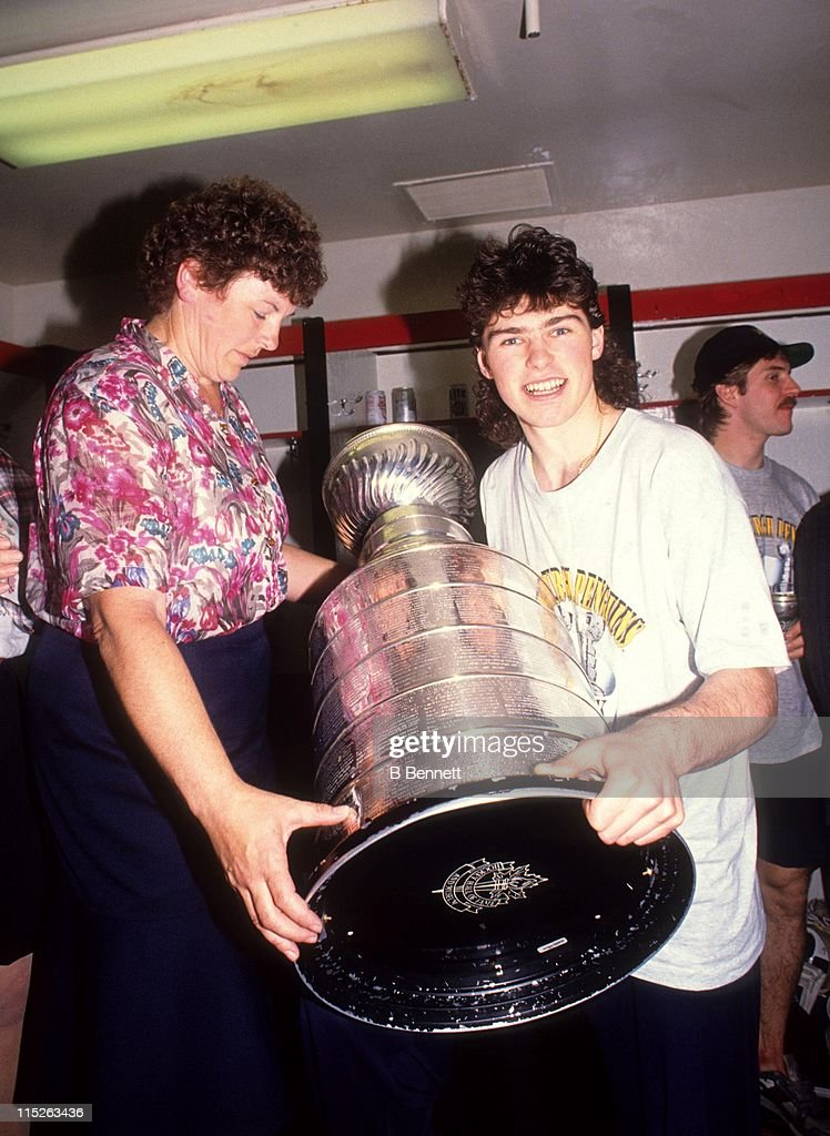 <a gi-track='captionPersonalityLinkClicked' href=/galleries/search?phrase=Jaromir+Jagr&family=editorial&specificpeople=201633 ng-click='$event.stopPropagation()'>Jaromir Jagr</a> #68 of the Pittsburgh Penguins poses with his mom and the Stanley Cup in the locker room after Game 4 of the 1992 Stanley Cup Finals against the Chicago Blackhawks on June 1, 1992 at the Chicago Stadium in Chicago, Illinois.