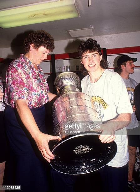Jaromir Jagr of the Pittsburgh Penguins poses with his mom and the Stanley Cup in the locker room after Game 4 of the 1992 Stanley Cup Finals against...