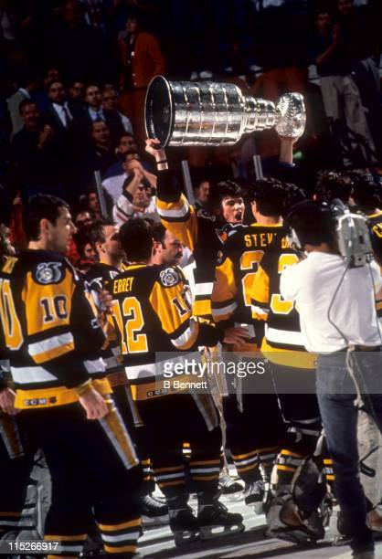 Jaromir Jagr of the Pittsburgh Penguins skates with the Stanley Cup after Game 6 of the 1991 Stanley Cup Finals against the Minnesota North Stars on...