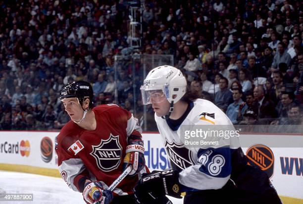 Jaromir Jagr of the World and the Pittsburgh Penguins skates on the ice as he is defended by Al MacInnis of North America and the St Louis Blues...