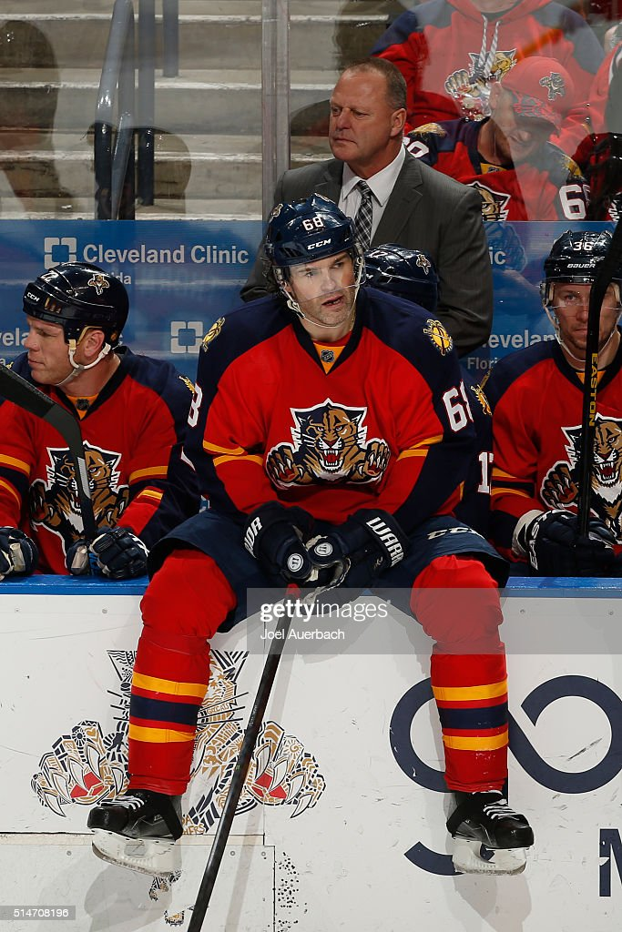 Jaromir Jagr #68 sits on the boards in front of head coach Gerald Gallant of the Florida Panthers during a third period break in action against the Ottawa Senators at the BB&T Center on March 10, 2016 in Sunrise, Florida. The Panthers defeated the Senators 6-2.