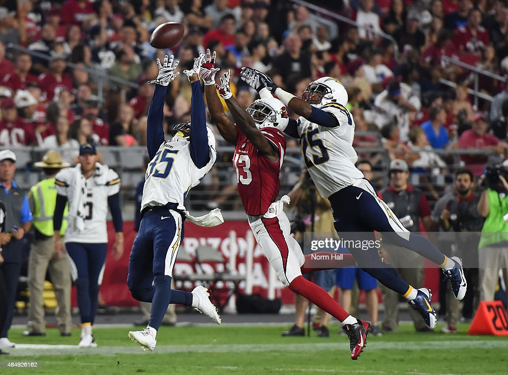 Jaron Brown #13 of the Arizona Cardinals battles for the ball with Richard Crawford #35 and Darrell Stuckey #25 ofthe San Diego Chargers during the second quarter at University of Phoenix Stadium on August 22, 2015 in Glendale, Arizona.
