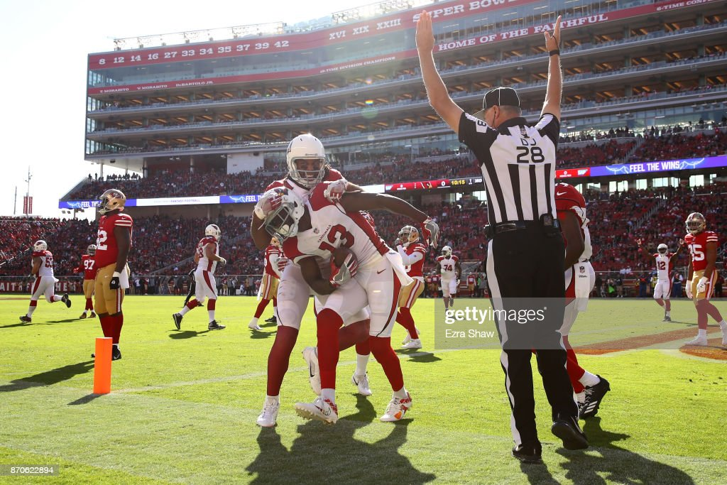 Jaron Brown #13 of the Arizona Cardinals celebrates with Larry Fitzgerald #11 after a touchdown against the San Francisco 49ers during their NFL game at Levi's Stadium on November 5, 2017 in Santa Clara, California.