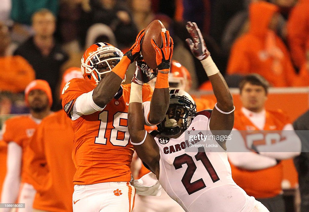 <a gi-track='captionPersonalityLinkClicked' href=/galleries/search?phrase=Jaron+Brown&family=editorial&specificpeople=234953 ng-click='$event.stopPropagation()'>Jaron Brown</a> #18 of the Clemson Tigers battles for a ball with DeVonte Holloman #21 of the South Carolina Gamecocks during their game at Memorial Stadium on November 24, 2012 in Clemson, South Carolina.