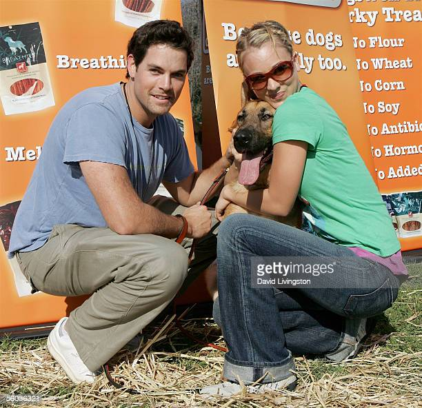 Jaron Lowenstein and Kaley Cuoco pose with Zeus at the Dogswell Dog Treats presents the Fourth Annual Much Love Animal Rescue Bow Wow Ween on October...
