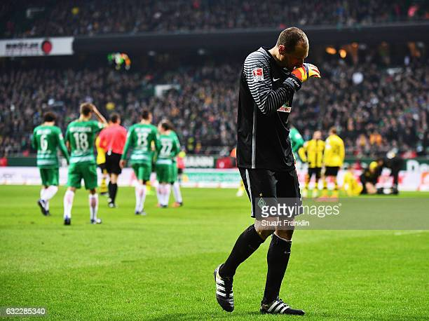 Jaroslav Drobny of Bremenwalks off after being shown the red card for his kick on Marco Reus of Dortmund during the Bundesliga match between Werder...