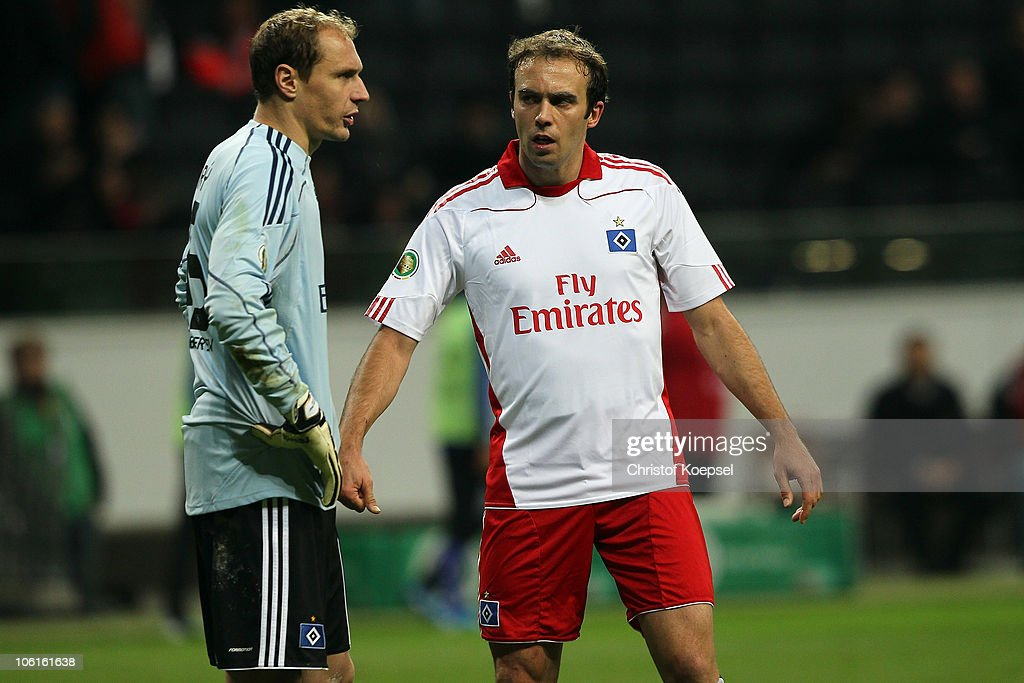 Jaroslav Drobny of Hamburg and Joris Mathijsen of Hamburg look dejected after the DFB Cup match between Eintracht Frankfurt and Hamburger SV at Commerzbank Arena on October 27, 2010 in Frankfurt am Main, Germany The match between Frankfurt and Hamburg ended 5-2.