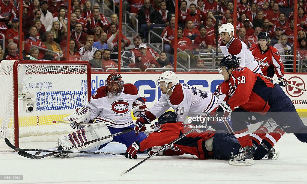 <a gi-track='captionPersonalityLinkClicked' href=/galleries/search?phrase=Jaroslav+Halak&family=editorial&specificpeople=2285591 ng-click='$event.stopPropagation()'>Jaroslav Halak</a> #41and <a gi-track='captionPersonalityLinkClicked' href=/galleries/search?phrase=Josh+Gorges&family=editorial&specificpeople=550446 ng-click='$event.stopPropagation()'>Josh Gorges</a> #26 of the Montreal Canadiens stop a third period scoring chance from <a gi-track='captionPersonalityLinkClicked' href=/galleries/search?phrase=Eric+Fehr&family=editorial&specificpeople=566939 ng-click='$event.stopPropagation()'>Eric Fehr</a> #16 and <a gi-track='captionPersonalityLinkClicked' href=/galleries/search?phrase=Alexander+Semin&family=editorial&specificpeople=206654 ng-click='$event.stopPropagation()'>Alexander Semin</a> #28 of the Washington Capitals in Game Five of the Eastern Conference Quarterfinals during the 2010 NHL Stanley Cup Playoffs at the Verizon Center on April 23, 2010 in Washington, DC. The Habs defeated the Caps 2-1.Washington leads the best of seven series 3 games to 2.