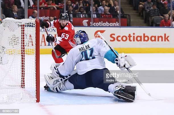 Jaroslav Halak of Team Europe makes a save off a shot from Brad Marchand of Team Canada during the World Cup of Hockey 2016 at Air Canada Centre on...