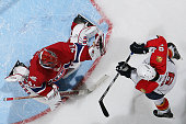 Jaroslav Halak of the Montreal Canadiens blocks the shot of Stephen Weiss of the Florida Panthers during the NHL game on March 25 2010 at the Bell...