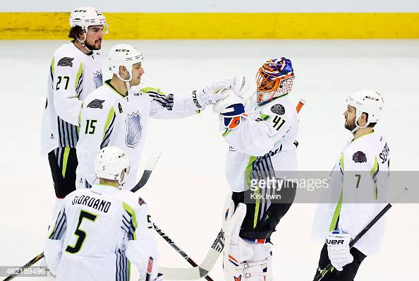 Jaroslav Halak of the New York Islanders and Team Toews Ryan Getzlaf of the Anaheim Ducks and Team Toews and teammates celebrate their 17 to 12 win...