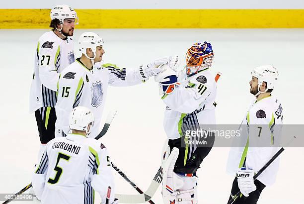 Jaroslav Halak of the New York Islanders and Team Toews Ryan Getzlaf of the Anaheim Ducks and Team Toews and teammates celebrate their 17 to 12 win...
