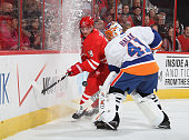 Jaroslav Halak of the New York Islanders goes behind the net to defend against Jiri Tlusty of the Carolina Hurricanes during their NHL game at PNC...