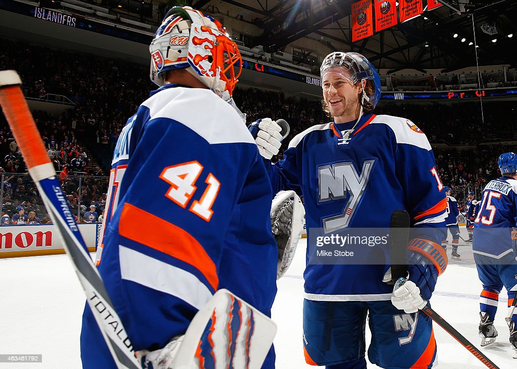 <a gi-track='captionPersonalityLinkClicked' href=/galleries/search?phrase=Jaroslav+Halak&family=editorial&specificpeople=2285591 ng-click='$event.stopPropagation()'>Jaroslav Halak</a> #41 of the New York Islanders is congratulated by teammate Matt Martin #17 after defeating the Columbus Blue Jackets at Nassau Veterans Memorial Coliseum on February 14, 2015 in Uniondale, New York. The New York Islanders defeated the Columbus Blue Jackets 6-3.