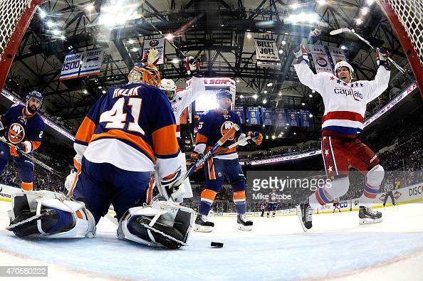 Jaroslav Halak of the New York Islanders looks on as Nicklas Backstrom of the Washington Capitals celebrates a second period goal scored by Alex...