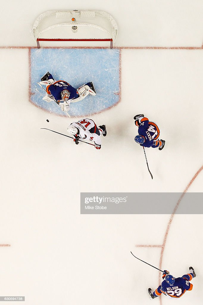 Jaroslav Halak #41 of the New York Islanders makes a save against Justin Williams #14 of the Washington Capitals at the Barclays Center on December 27, 2016 in Brooklyn borough of New York City.