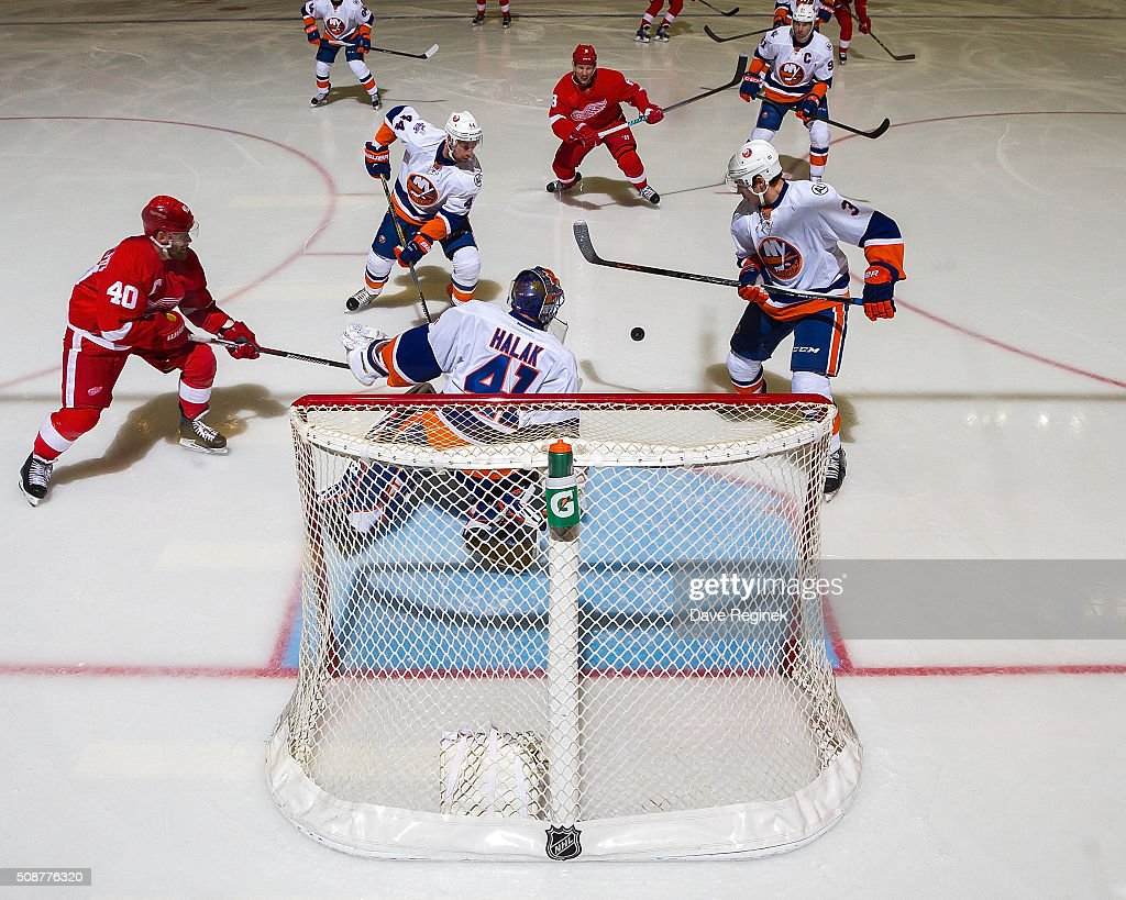 <a gi-track='captionPersonalityLinkClicked' href=/galleries/search?phrase=Jaroslav+Halak&family=editorial&specificpeople=2285591 ng-click='$event.stopPropagation()'>Jaroslav Halak</a> #41 of the New York Islanders makes a save as teammates <a gi-track='captionPersonalityLinkClicked' href=/galleries/search?phrase=Travis+Hamonic&family=editorial&specificpeople=4605791 ng-click='$event.stopPropagation()'>Travis Hamonic</a> and Thomas Hickey clear the puck as <a gi-track='captionPersonalityLinkClicked' href=/galleries/search?phrase=Henrik+Zetterberg&family=editorial&specificpeople=201520 ng-click='$event.stopPropagation()'>Henrik Zetterberg</a> #40 of the Detroit Red Wings reaches for the rebound during an NHL game at Joe Louis Arena on February 6, 2016 in Detroit, Michigan.
