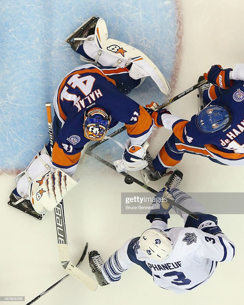 Jaroslav Halak of the New York Islanders makes a second period save on Dion Phaneuf of the Toronto Maple Leafs at the Nassau Veterans Memorial...