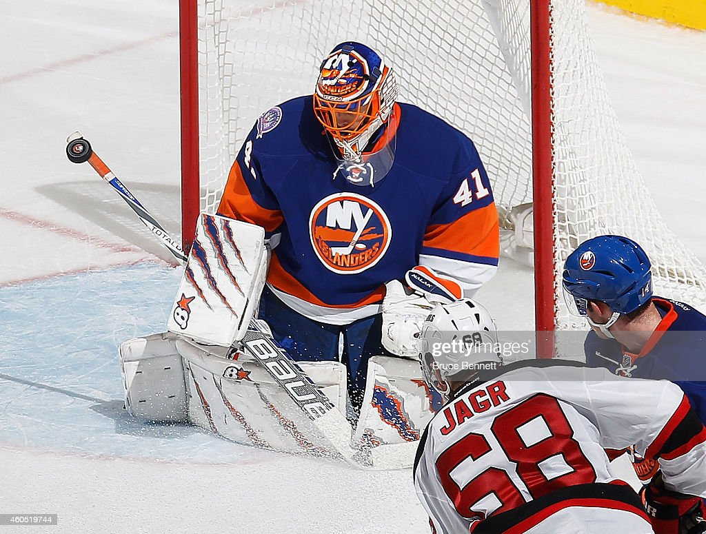 Jaroslav Halak of the New York Islanders makes stick save in overtime on Jaromir Jagr of the New Jersey Devils at the Nassau Veterans Memorial...