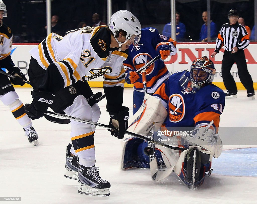 Jaroslav Halak of the New York Islanders makes the first period stop on Loui Eriksson of the Boston Bruins at the Barclays Center on October 23 2015...