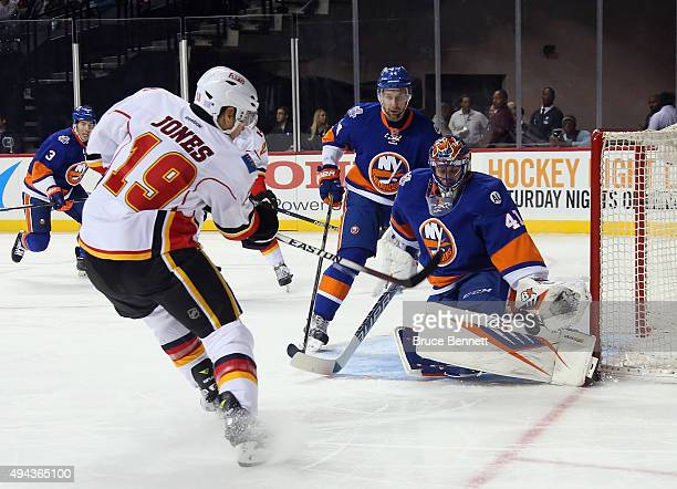 Jaroslav Halak of the New York Islanders makes the first period stop on David Jones of the Calgary Flames at the Barclays Center on October 26 2015...