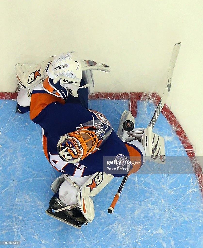 <a gi-track='captionPersonalityLinkClicked' href=/galleries/search?phrase=Jaroslav+Halak&family=editorial&specificpeople=2285591 ng-click='$event.stopPropagation()'>Jaroslav Halak</a> #41 of the New York Islanders makes the second period save against the Edmonton Oilers at the Nassau Veterans Memorial Coliseum on February 10, 2015 in Uniondale, New York. The Islanders defeated the Oilers 3-2.