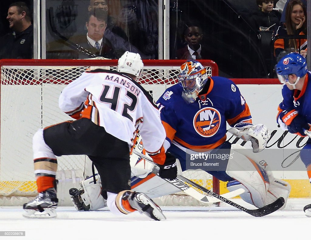 Jaroslav Halak of the New York Islanders makes the second period toe save on Josh Manson of the Anaheim Ducks at the Barclays Center on December 21...