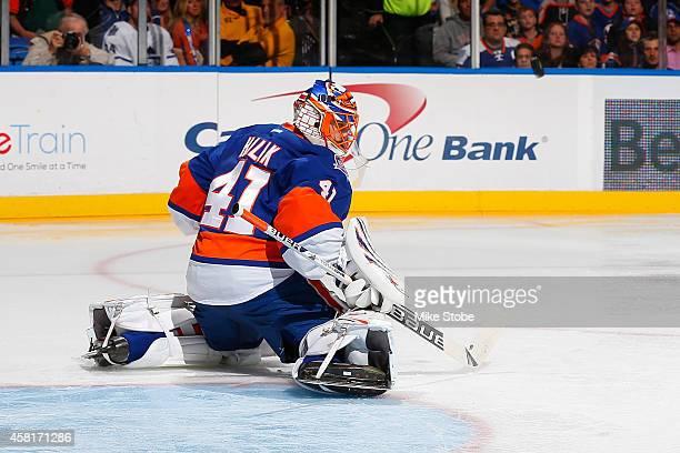 Jaroslav Halak of the New York Islanders skates against the Toronto Maple Leafs at Nassau Veterans Memorial Coliseum on October 21 2014 in Uniondale...