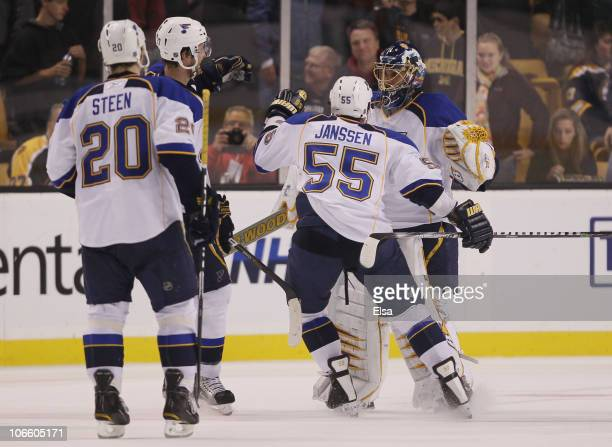 Jaroslav Halak of the St Louis Blues celebrates the win with teammates Cam Janssen and Alexander Steen after the shootout against the Boston Bruins...