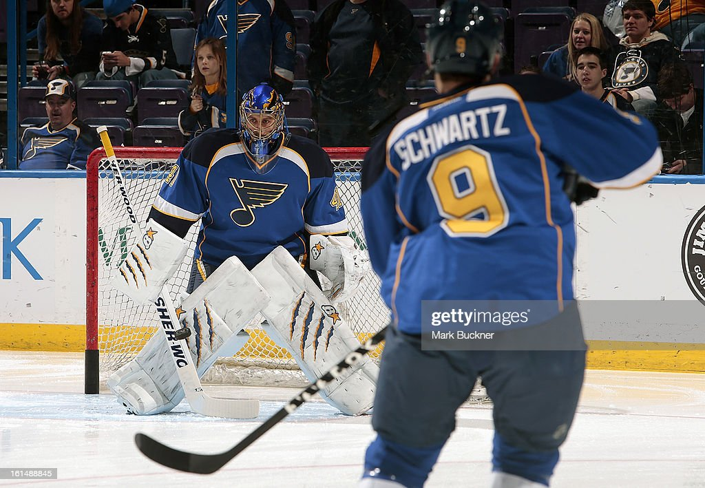 Jaroslav Halak #41 of the St. Louis Blues faces a shot from teammate Jaden Schwartz #9 during warm-ups before an NHL game against the Los Angeles Kings on February 11, 2013 at Scottrade Center in St. Louis, Missouri.