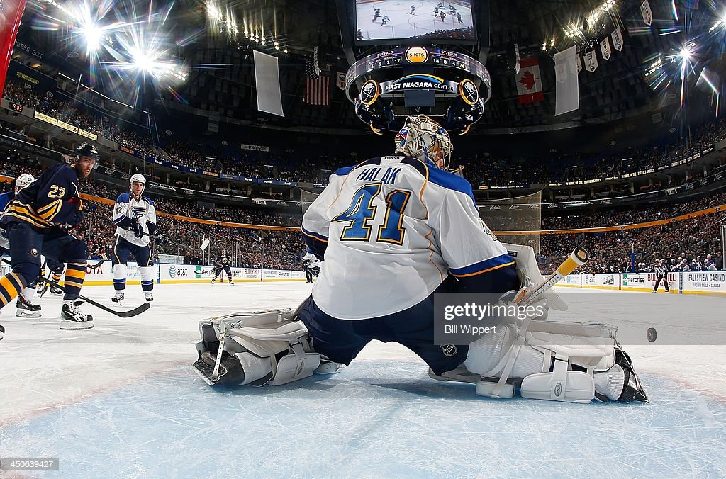 <a gi-track='captionPersonalityLinkClicked' href=/galleries/search?phrase=Jaroslav+Halak&family=editorial&specificpeople=2285591 ng-click='$event.stopPropagation()'>Jaroslav Halak</a> #41 of the St. Louis Blues makes a pad save as <a gi-track='captionPersonalityLinkClicked' href=/galleries/search?phrase=Ville+Leino&family=editorial&specificpeople=4025199 ng-click='$event.stopPropagation()'>Ville Leino</a> #23 of the Buffalo Sabres looks for a rebound on November 19, 2013 at the First Niagara Center in Buffalo, New York. St. Louis won, 4-1.