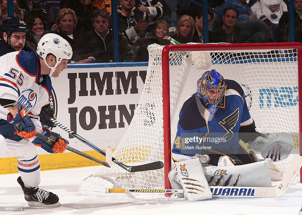 <a gi-track='captionPersonalityLinkClicked' href=/galleries/search?phrase=Jaroslav+Halak&family=editorial&specificpeople=2285591 ng-click='$event.stopPropagation()'>Jaroslav Halak</a> #41 of the St. Louis Blues makes a save on a shot from <a gi-track='captionPersonalityLinkClicked' href=/galleries/search?phrase=Ben+Eager&family=editorial&specificpeople=570537 ng-click='$event.stopPropagation()'>Ben Eager</a> #55 of the Edmonton Oilers in an NHL game on March 1, 2013 at Scottrade Center in St. Louis, Missouri.