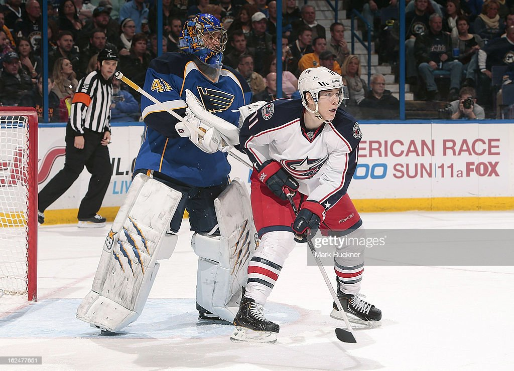 <a gi-track='captionPersonalityLinkClicked' href=/galleries/search?phrase=Jaroslav+Halak&family=editorial&specificpeople=2285591 ng-click='$event.stopPropagation()'>Jaroslav Halak</a> #41 of the St. Louis Blues tries to clear Matt Calvert #11 of the Columbus Blue Jackets from the crease in an NHL game on February 23, 2013 at Scottrade Center in St. Louis, Missouri.