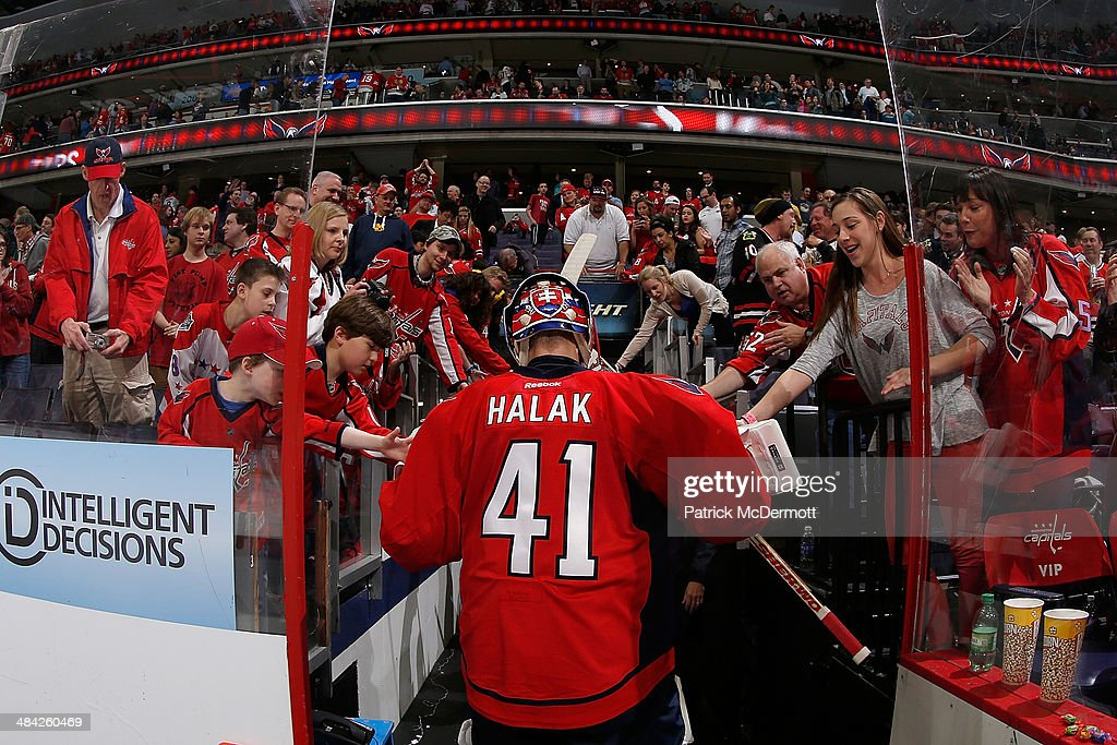 <a gi-track='captionPersonalityLinkClicked' href=/galleries/search?phrase=Jaroslav+Halak&family=editorial&specificpeople=2285591 ng-click='$event.stopPropagation()'>Jaroslav Halak</a> #41 of the Washington Capitals celebrates with fans as he walks to the locker room after the Capitals defeated the Chicago Blackhawks 4-0 during an NHL game at Verizon Center on April 11, 2014 in Washington, DC.