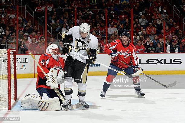 Jaroslav Halak of the Washington Capitals makes a save against Chris Kunitz of the Pittsburgh Penguins in the third period during an NHL game at...