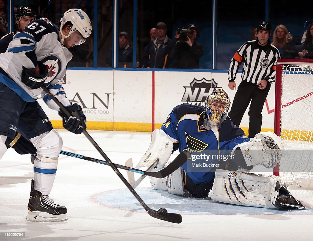 Jaroslav Halak #41of the St. Louis Blues sets to make a save on a shot from Michael Frolik #67 of the Winnipeg Jets on October 29, 2013 at Scottrade Center in St. Louis, Missouri.