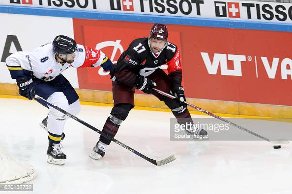 Jaroslav Hlinka of HC Sparta Prague challenges Kristoffer Persson of Jonkoping during the Champions Hockey League Round of 16 match between Sparta...