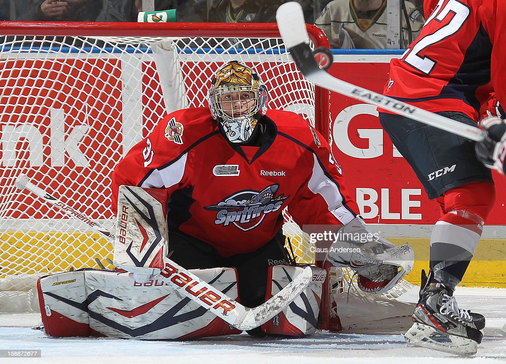 Jaroslav Pavelka #31 of the Windsor Spitfires keeps an eye on a high puck in an OHL game against the London Knights on December 27, 2012 at the Budweiser Gardens in London, Canada. The Knights defeated the Spitfires 9-4 to extend their winning streak to 22 games.