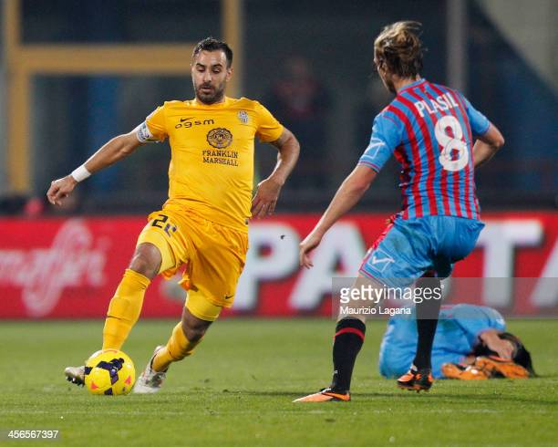 Jaroslav Plasil of Catania competes for the ball with Domenico Maietta of Hellas Verona during the Serie A match between Calcio Catania and Hellas...