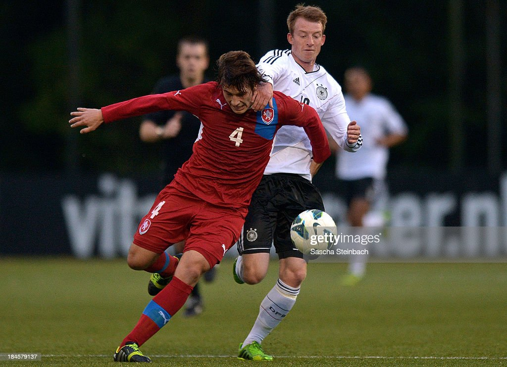 Jaroslav Svozil of Czech Republic and <a gi-track='captionPersonalityLinkClicked' href=/galleries/search?phrase=Maximilian+Arnold&family=editorial&specificpeople=7166144 ng-click='$event.stopPropagation()'>Maximilian Arnold</a> of Germany battle for the ball during the U20 juniors tournament match between the Czech Republic and Germany on October 14, 2013 in Gemert, Netherlands.