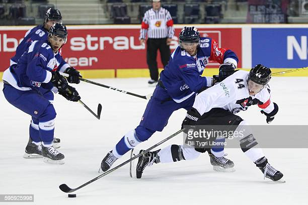 Jaroslav Vlach Mario Bliznak Martin Sevc of Bili Tygri Liberec and Elias Karvonen of TPS Turku during the Champions Hockey League match between Bili...