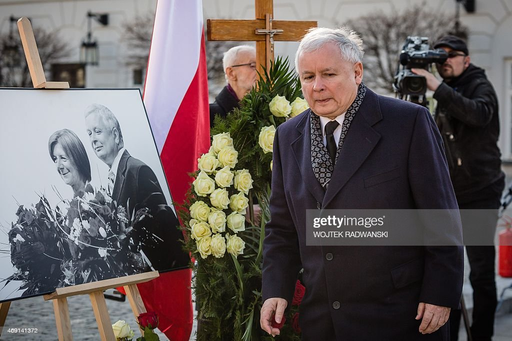 <a gi-track='captionPersonalityLinkClicked' href=/galleries/search?phrase=Jaroslaw+Kaczynski&family=editorial&specificpeople=576447 ng-click='$event.stopPropagation()'>Jaroslaw Kaczynski</a>, leader of Law and Justice party (PiS) and twin brother of late Polish president <a gi-track='captionPersonalityLinkClicked' href=/galleries/search?phrase=Lech+Kaczynski&family=editorial&specificpeople=544054 ng-click='$event.stopPropagation()'>Lech Kaczynski</a>, his co-workers and supporters attend a ceremony marking the fifth anniversary of the presidential plane crash in Smolensk, in front of the presidential palace in Warsaw, on April 10, 2015.