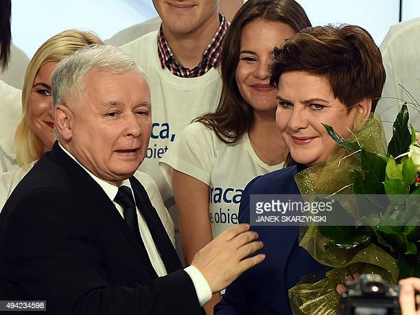 Jaroslaw Kaczynski leader of the conservative opposition Law and Justice and Beata Szydlo candidate for prime minister celebrate with supporters at...