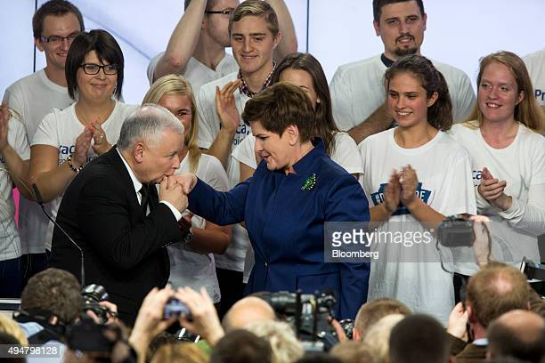 Jaroslaw Kaczynski leader of the opposition Law and Justice Party left greets Beata Szydlo deputy chairman of the opposition party and candidate for...