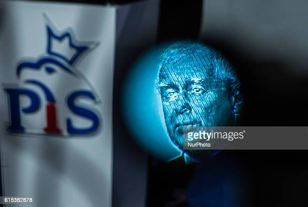 Jaroslaw Kaczynski's face seen through the viewfinder of the camera next to the sign of the party law and justice at the press conference of Jaroslaw...